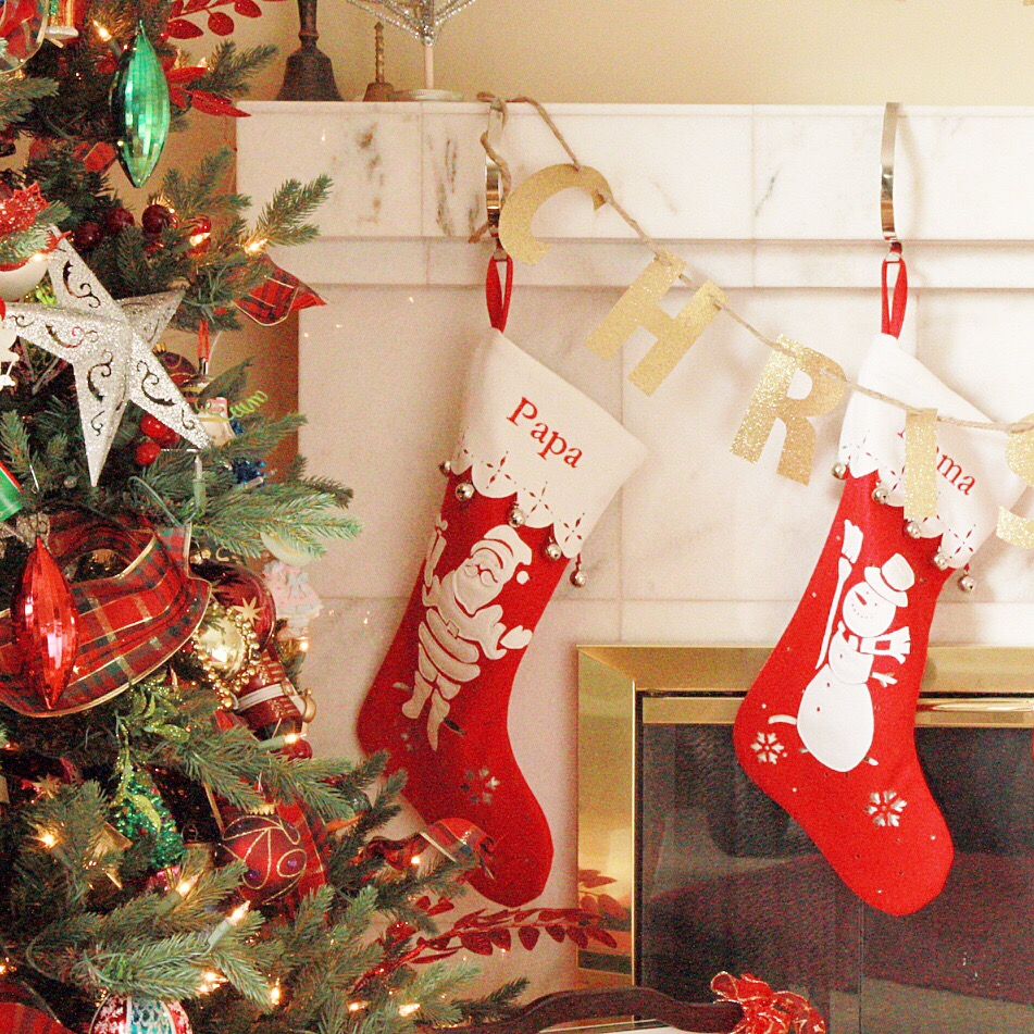 Papa and Mama stockings hanging on the mantel.