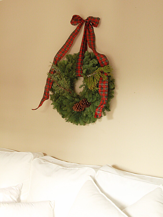 A green wreath hanging on the wall.