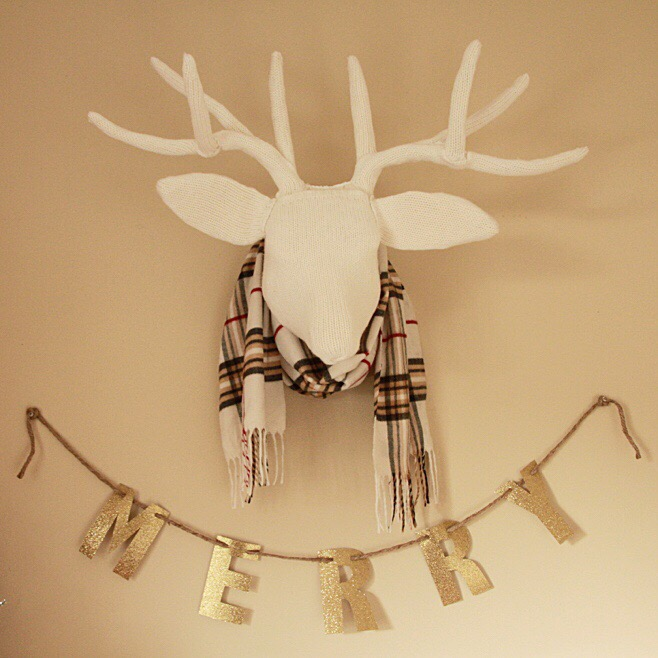 White antlers with a scarf around the head.