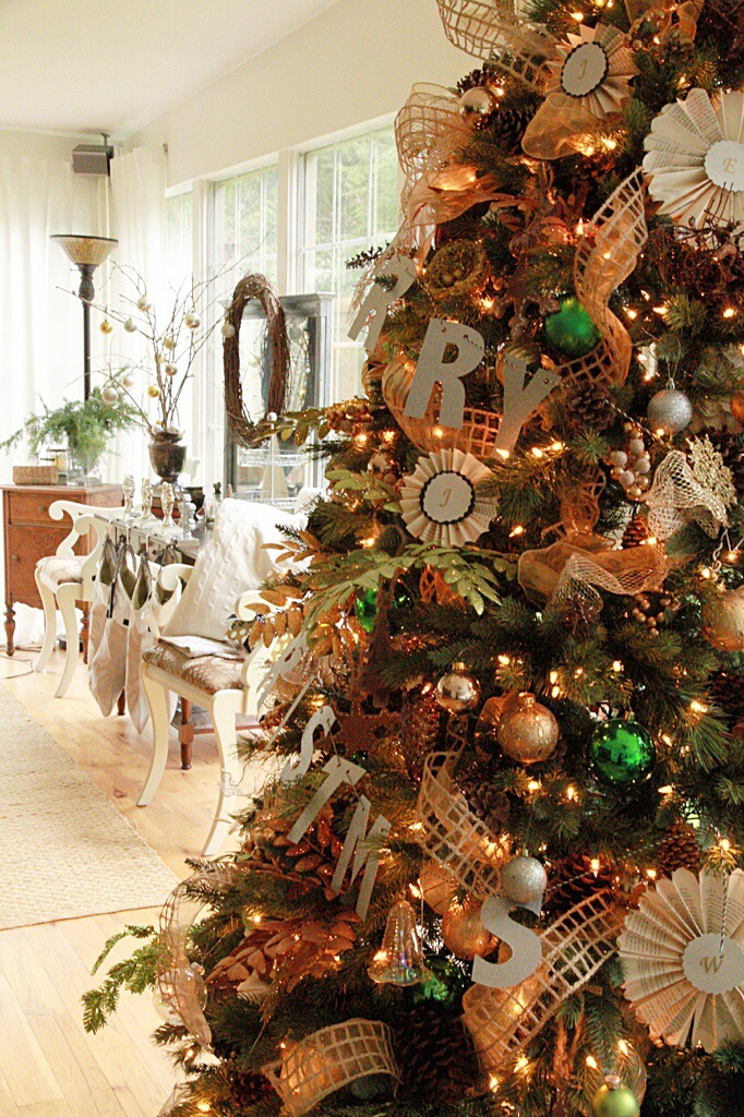 A large decorated Christmas tree by the dining room.