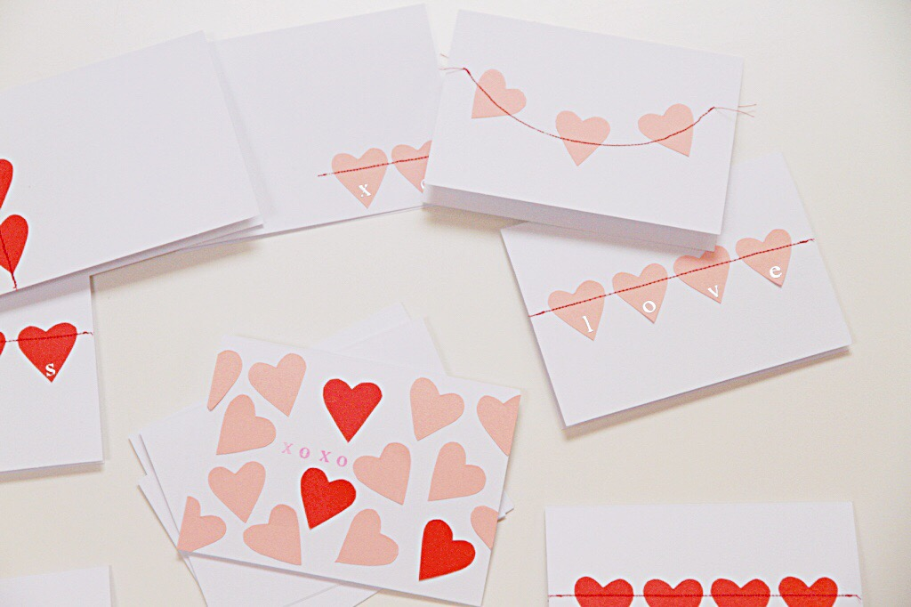 A card on the table with lots of hearts on it and xoxo in the middle of it.