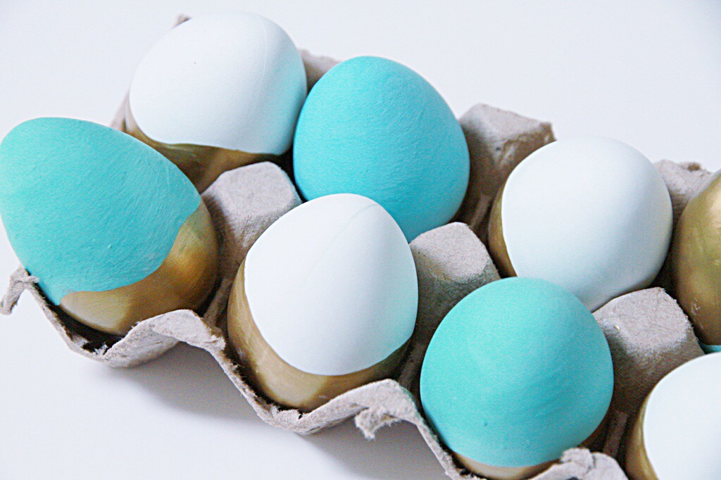 Blue, white and gold painted Easter eggs.