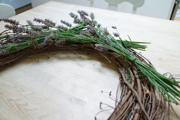 Placing the bundles of lavender around the wreath.