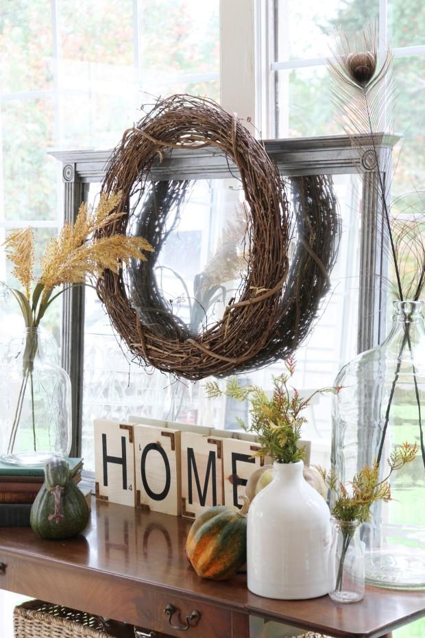 Twine wreath on mirror above dresser.