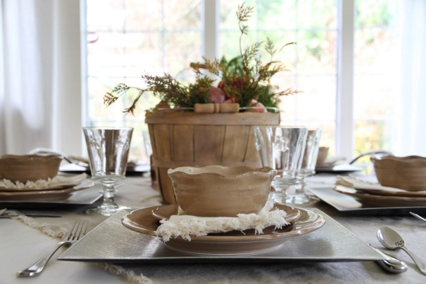 Thanksgiving table setting with wooden centerpiece.