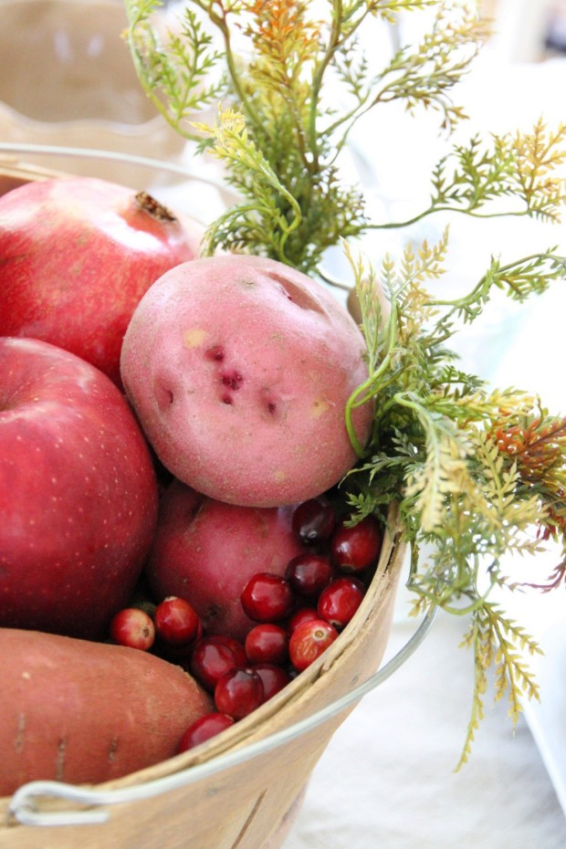 Potatoes and cranberries in a wooden bucket.