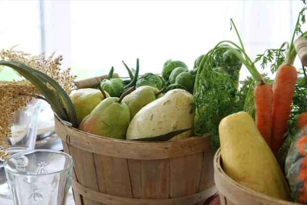 Colorful orange, green and yellow vegetables in the buckets.