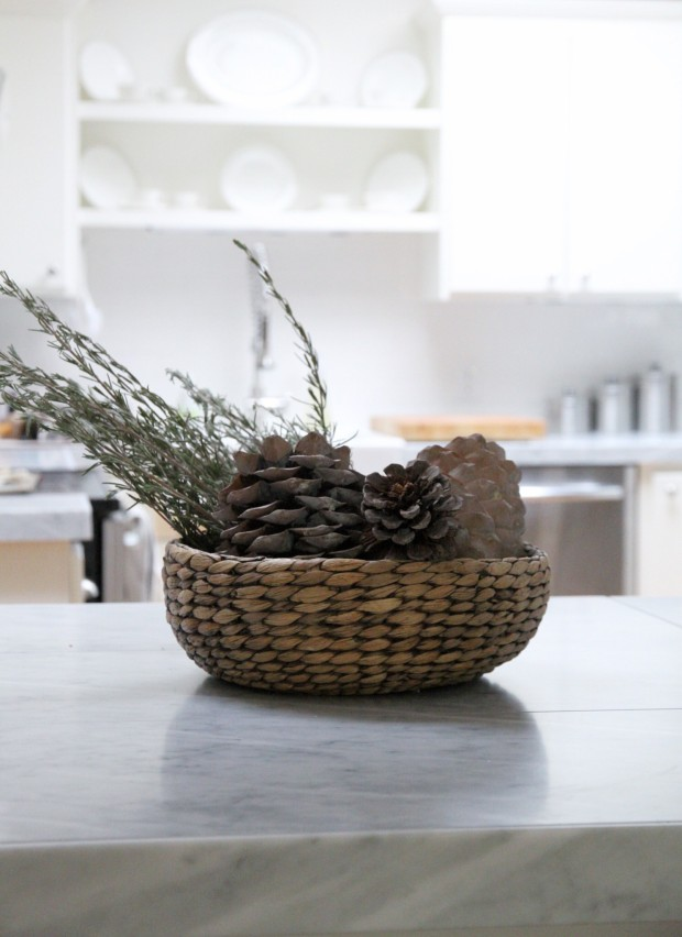 Pinecones in a basket on the kitchen island.