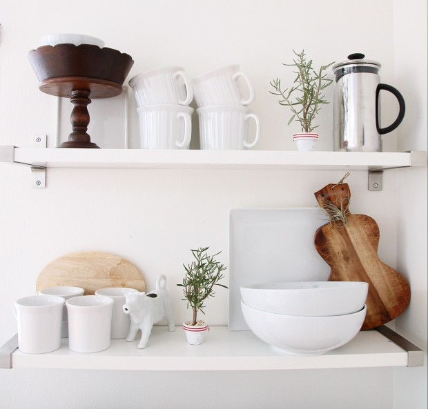 Cups, bowls, a bread board, and cake stand plus the little tree in the kitchen on the shelf.
