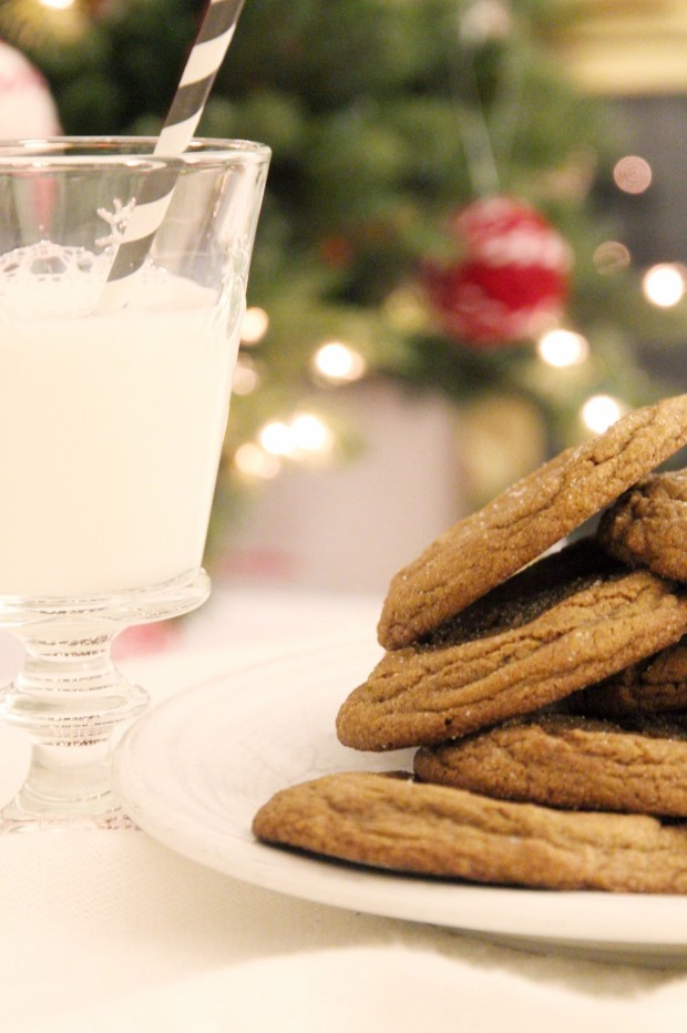 Up close picture of of the molasses cookies and a glass of milk.