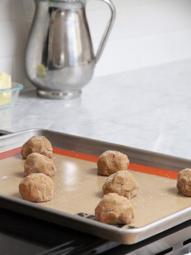Cookie dough balls on a cookie sheet ready to be baked.