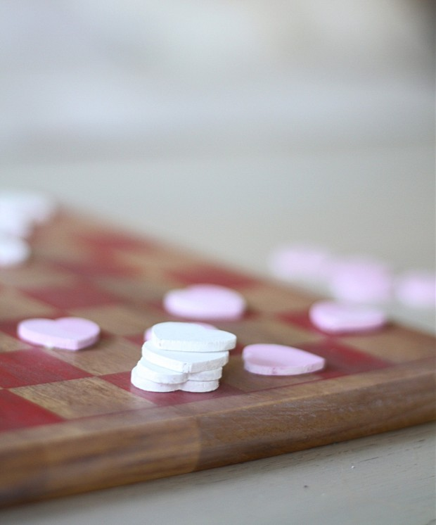 The pink heart checker pieces stacked on top of each other.