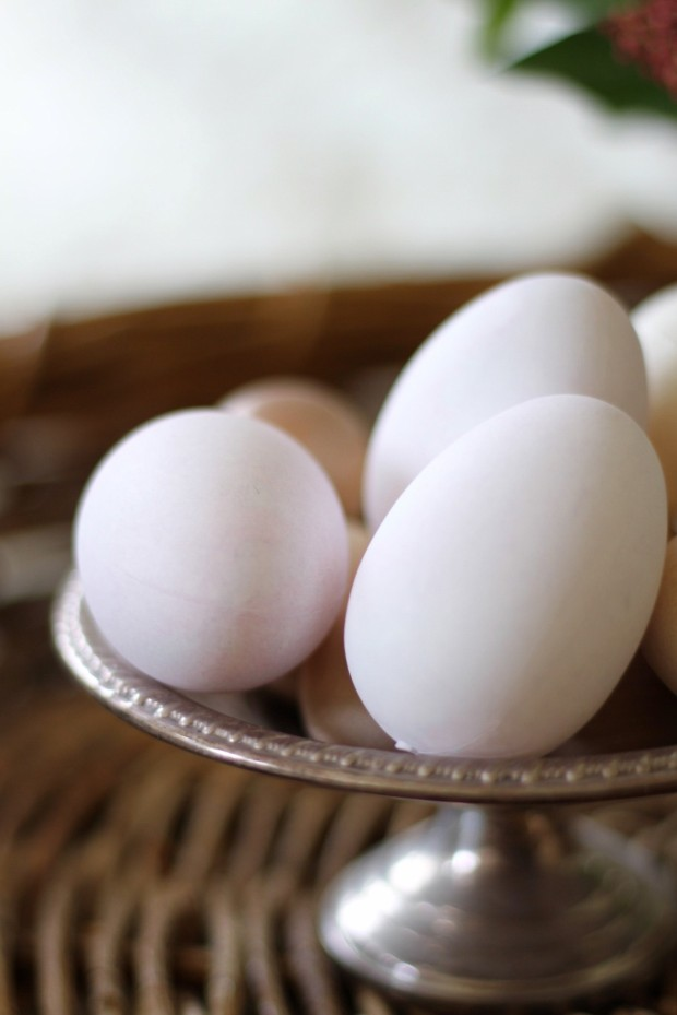 The tea dyed eggs on a cake stand.