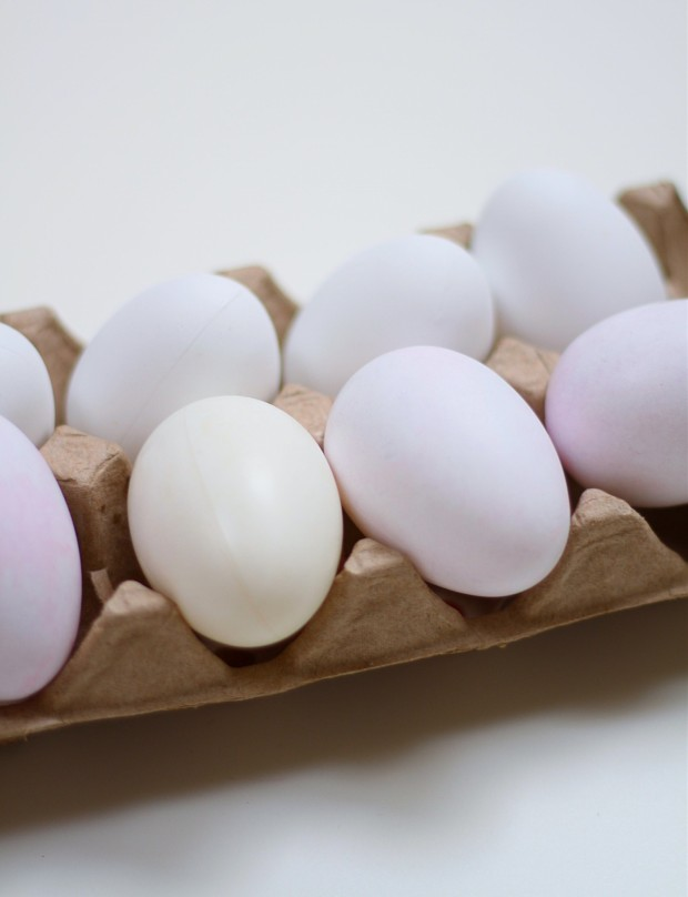 The soft dyed eggs in a cardboard container.