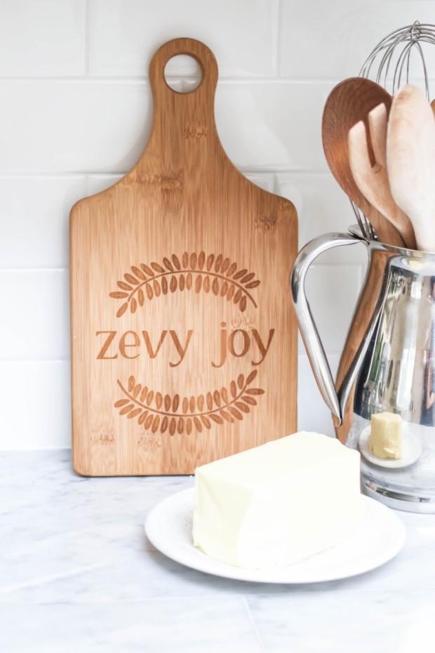 A wooden Zevy Joy wooden cutting board.