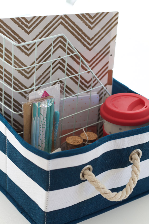 Blue and white striped gift basket filled with school items.