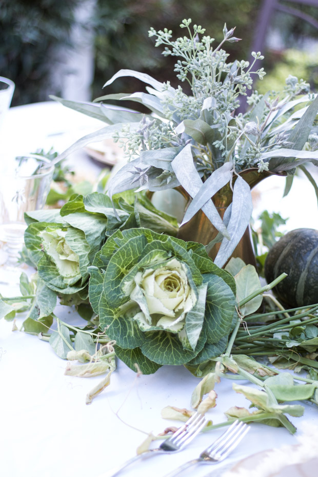 Eucalyptus bouquet with lots of greenery with it on the counter.