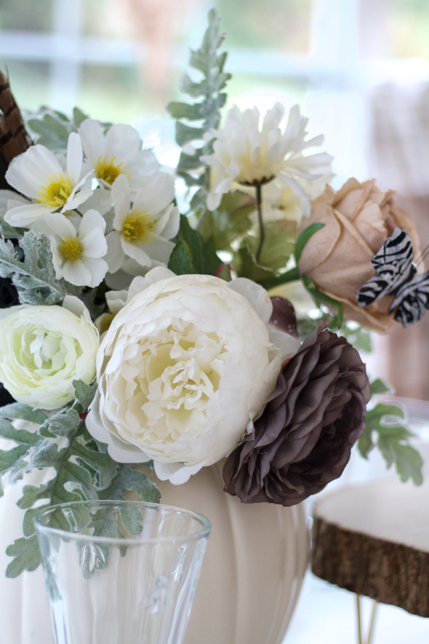 White, brown and blush floral arrangement on table.