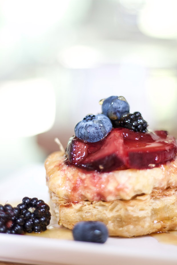 Blackberries, blueberries on top of pastry shell that is baked.