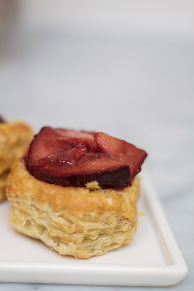 The plums on top of the pastry.