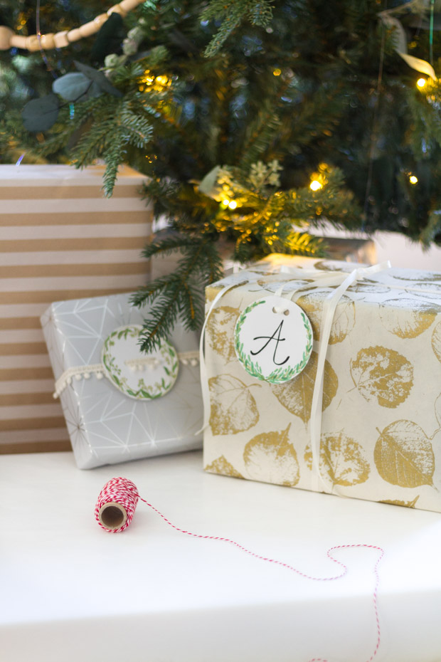 A Christmas greenery gift tag with the letter A on it.