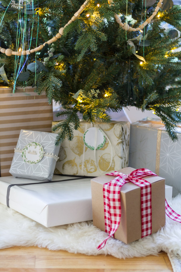 A present wrapped in kraft paper with a checkered red and white bow on it.