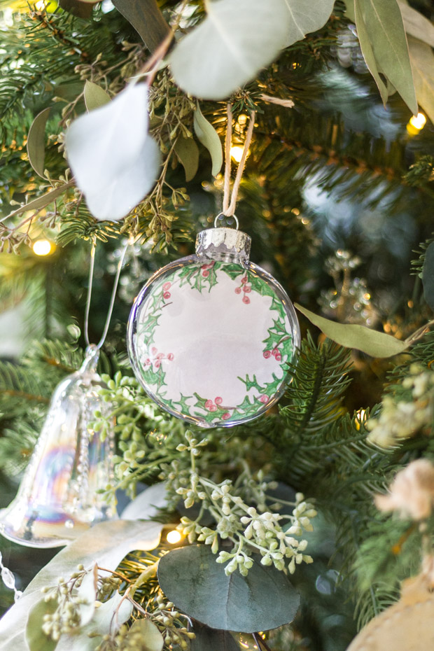A clear Christmas ornament with the printable inside it.