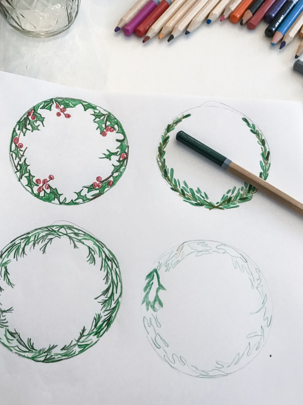 Using colored pencils to draw the greenery on a white piece of paper.