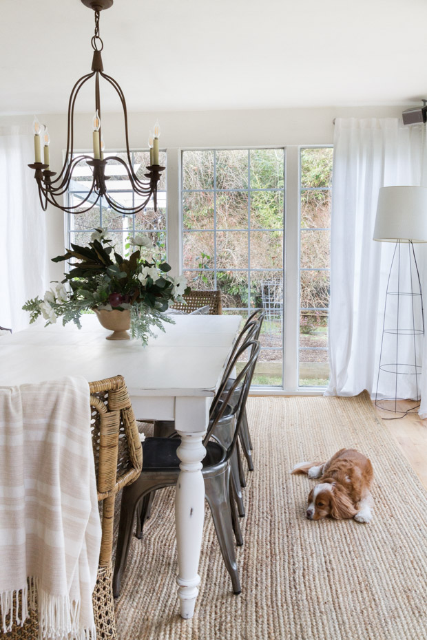 Dining room table with a little dog beside it.