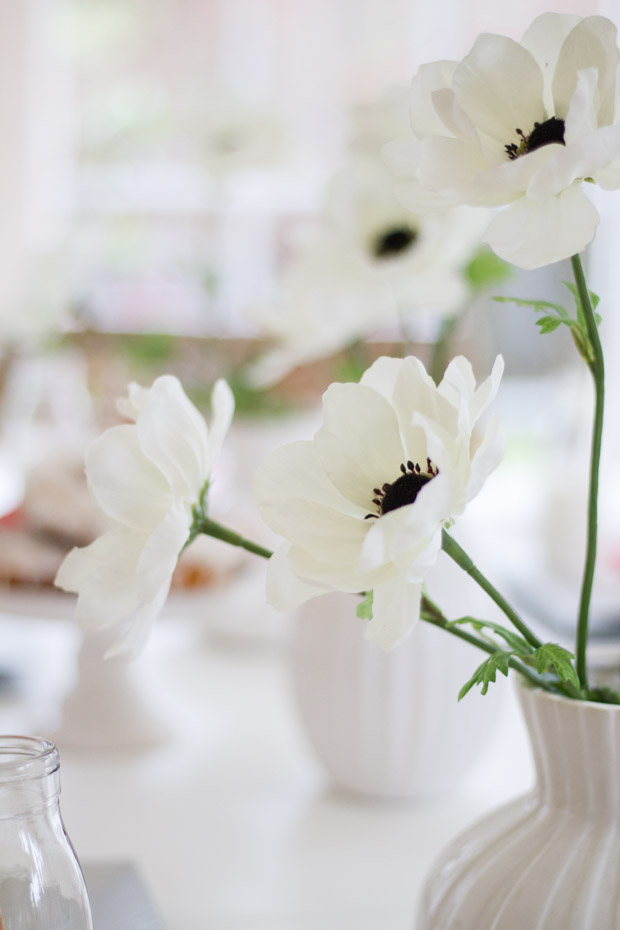 White flowers in a white vase.