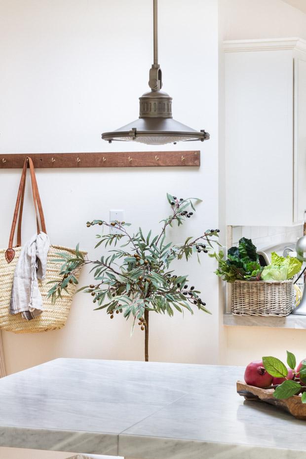 Olive branch in kitchen.