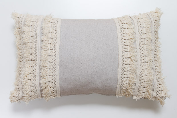 The pillow with the fringe on it.