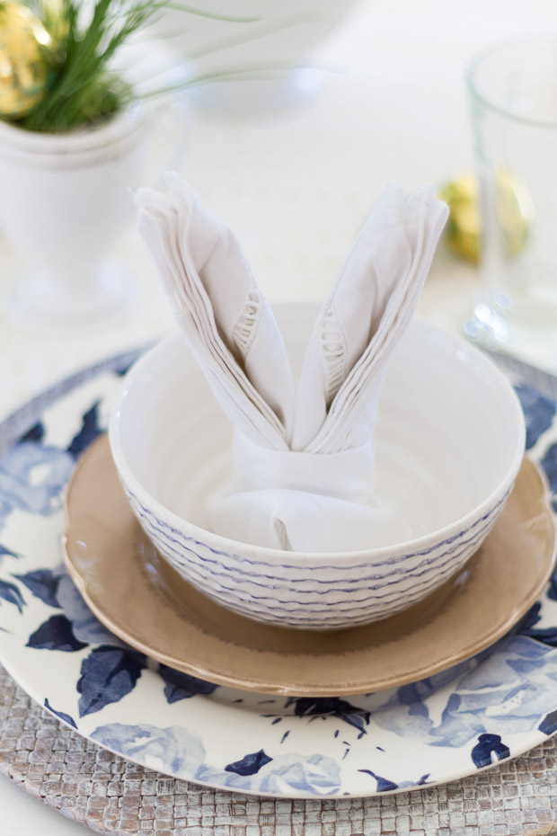 White and blue bowls and plates set for Easter.