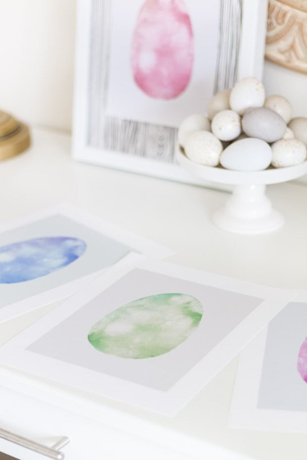 The watercolor printable in various shades of blue and green on the desk.