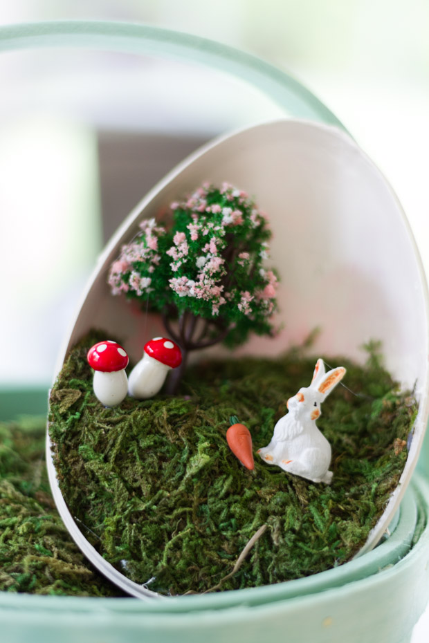 Putting the little figurines inside the Easter egg.