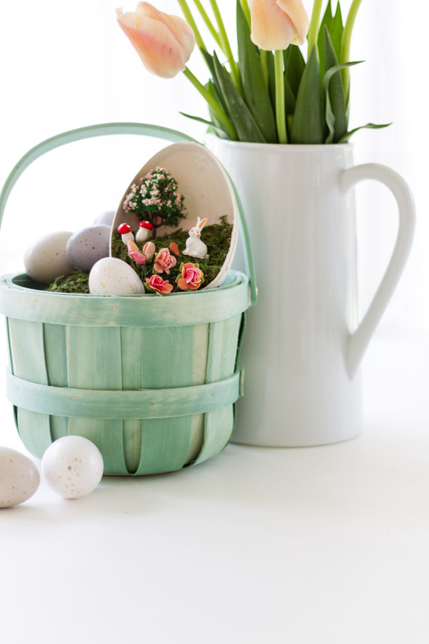 The green basket with the half plastic decorated Easter egg in it on the counter.