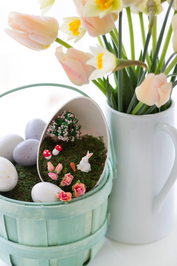 The flowers on the table beside the Easter Basket.