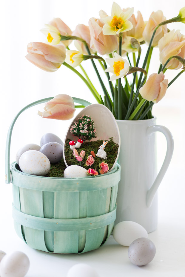 Two plain Easter eggs on the table beside the basket.
