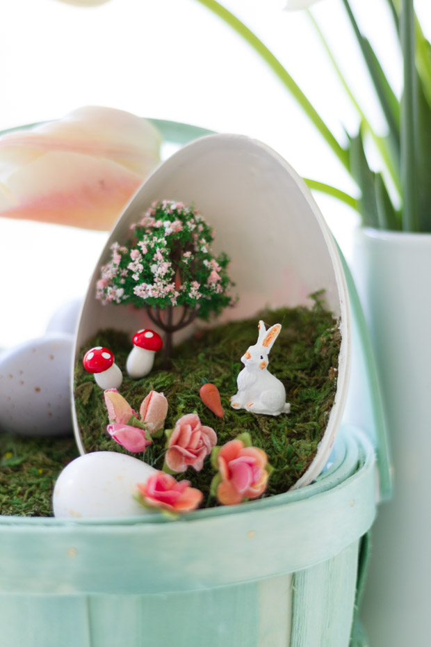 Up close of the little bunny, tree mushrooms, and flowers inside the plastic egg.