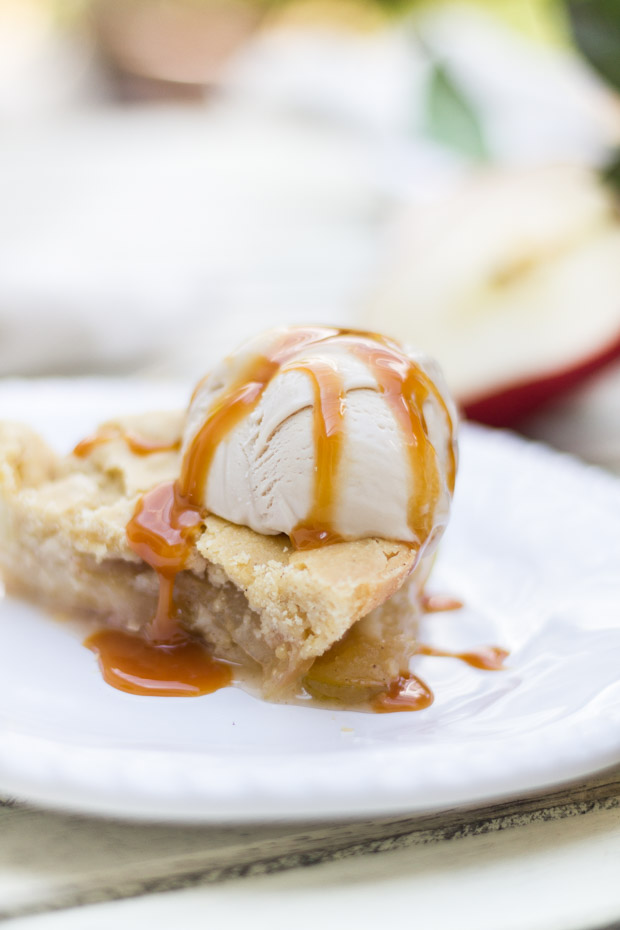 Apple pie baked with ice cream over top.