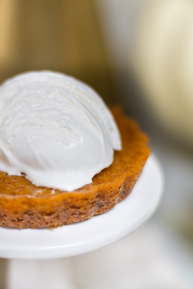 A dollop of whipped cream on the mini tart.
