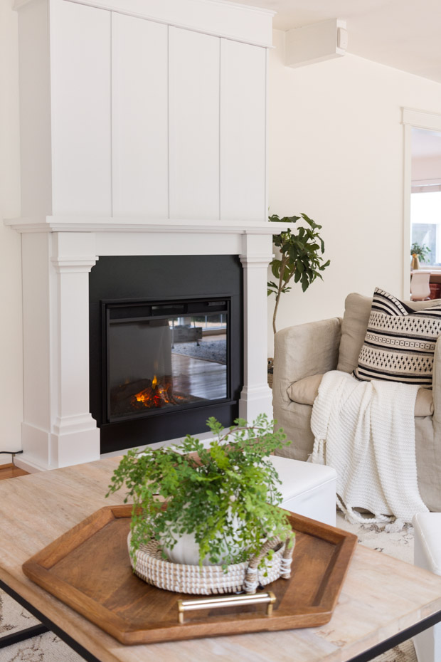 White mantel and black fireplace.