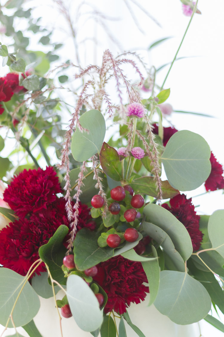 Small red berries added to arrangement.