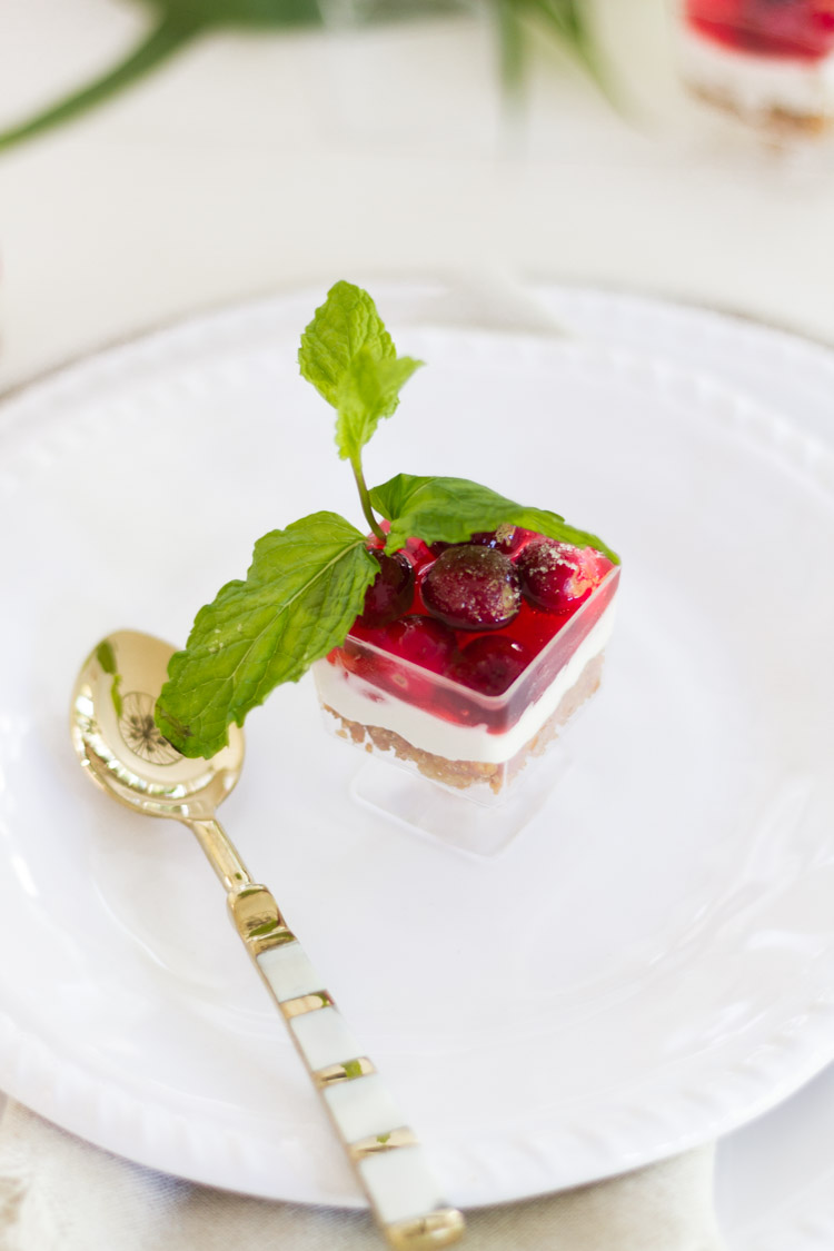 Up close of the individual cranberry salad with a gold spoon beside it.