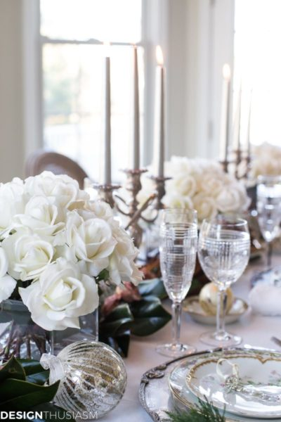 White roses on a table with candles.