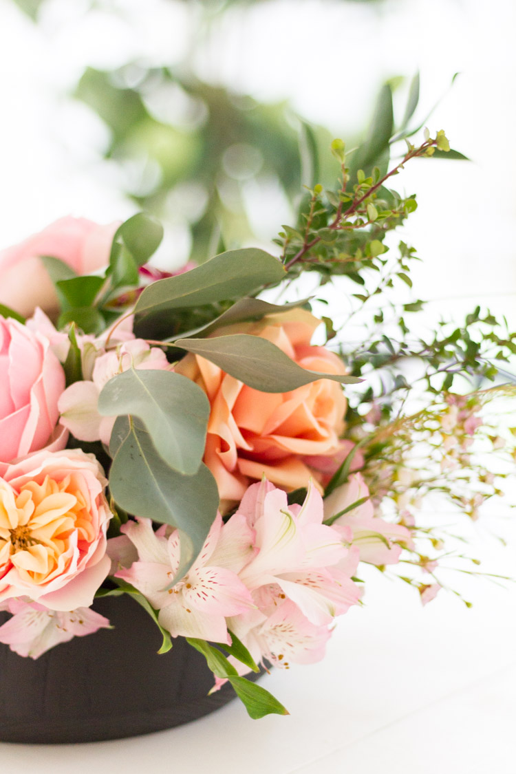 Up close picture of the floral arrangement on the table.