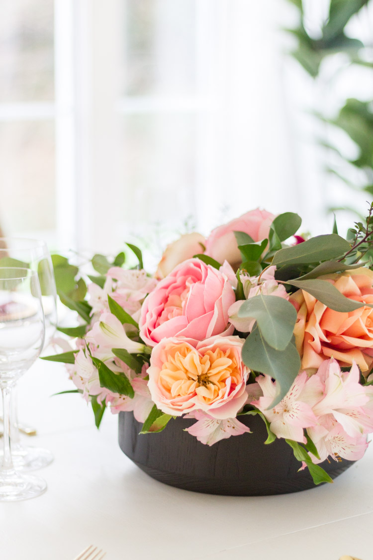 Pink peony and roses in the centerpiece.