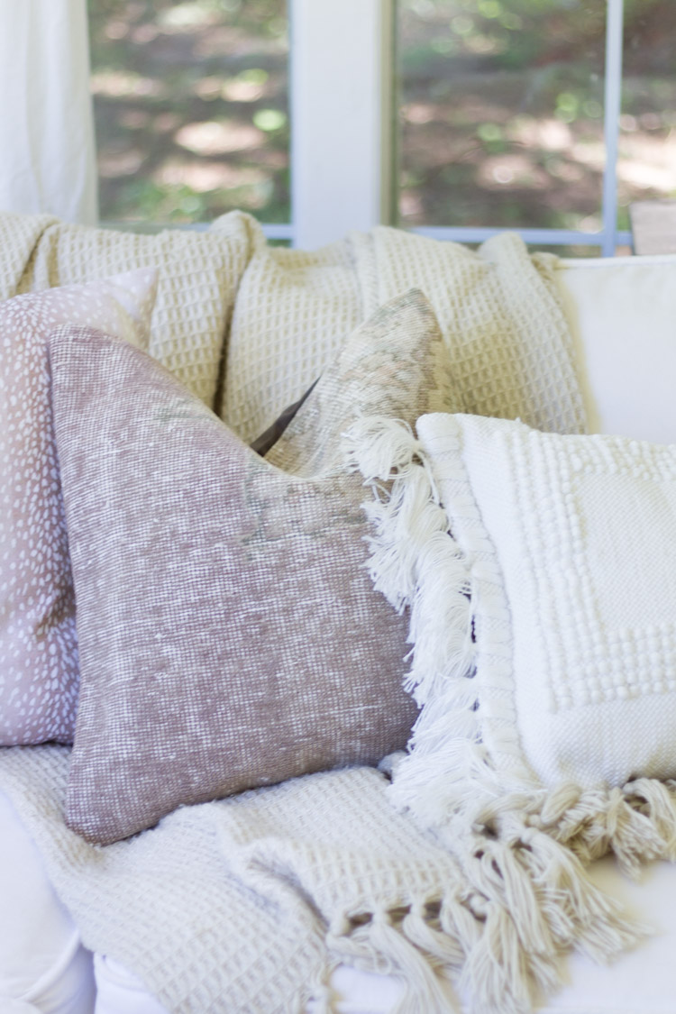 Pale light colored pillows on couch.
