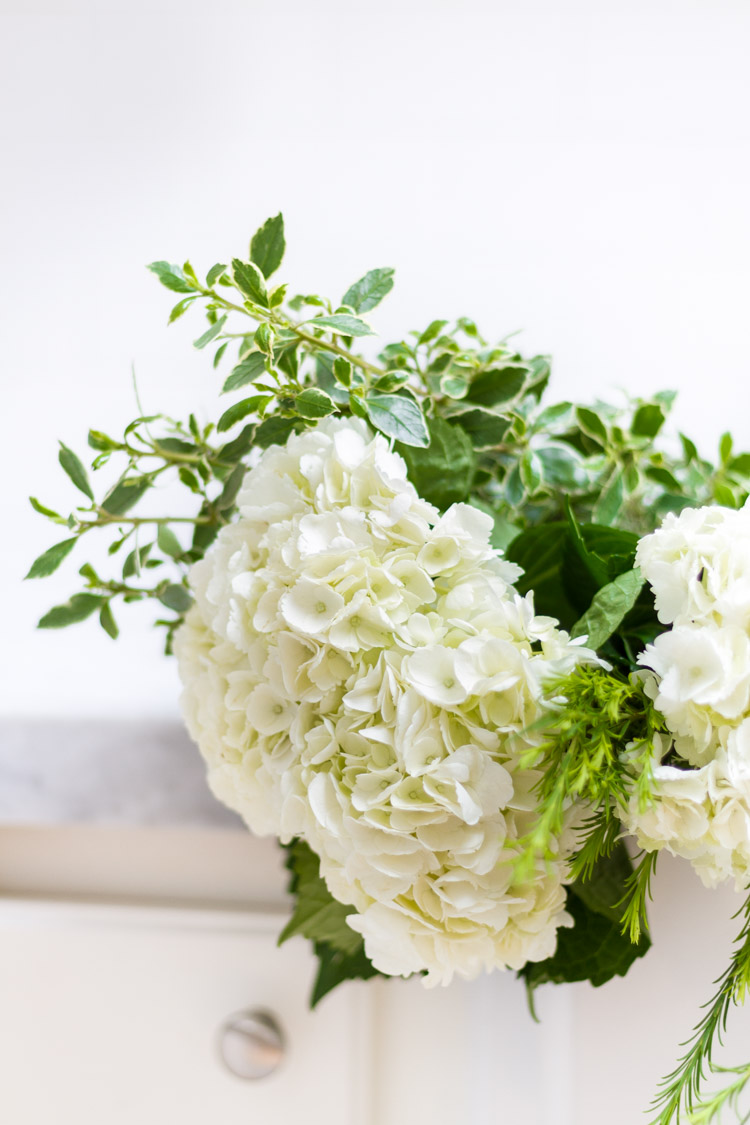 White flowers with greenery.