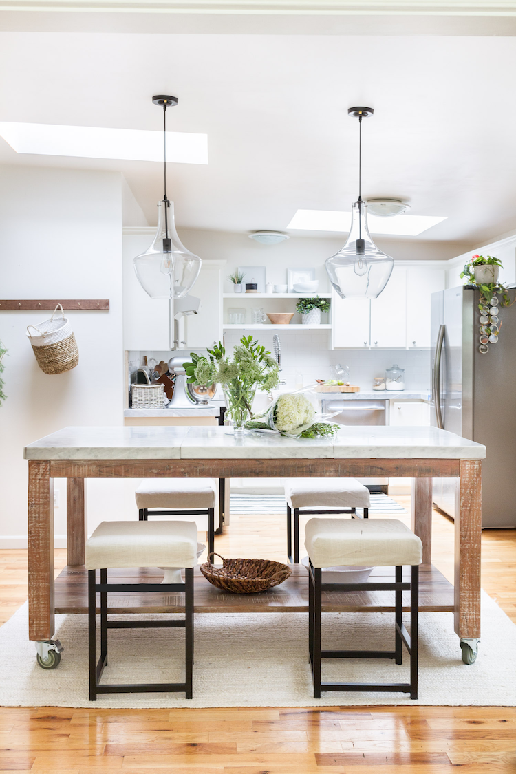 Kitchen island with pendant lights above it.